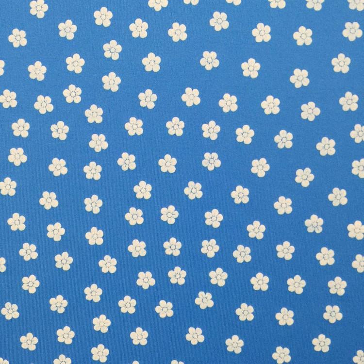 Lycra flor fondo azul