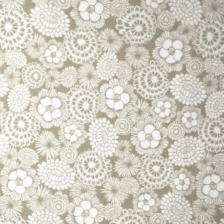 Algodón estampado floral beige y blanco